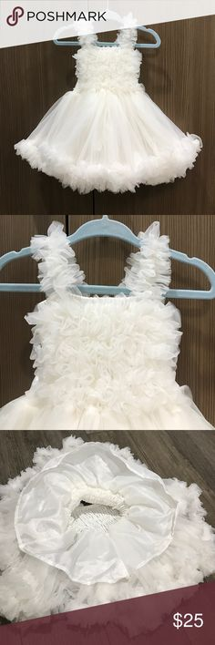 LN RUFFLE BUTTS petti dress LN RUFFLE BUTTS infant/baby girls petti dress tutu. Great for a special occasion/birthday/party/flower girl/summer wedding etc. My daughter wore this for a one hour photo session at our home. Soft off white/Ivory chiffon. Tank/sleeveless. Elasticized body. Tons of ruffles! RUFFLE petticoat design. White satin ribbon can be tied into a bow in back. Size: 0-12 months Ruffle Butts Dresses