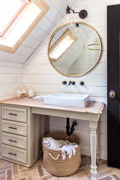 Cottage Style Bathroom Idea with Brick Floors