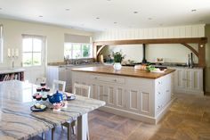 To complement the kitchen, Hill Farm also created a handmade table complete with matching granite top. The perfect place for a brew!