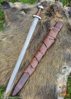 Early Viking Sword with Damascus steel blade. Beautiful reconstruction of the sword wielded by the Danish King Godfred.