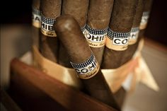 Cohibas. Everyone should experience a Cuban made Cohiba at least once