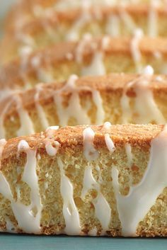 Lemon-Almond Biscotti Recipe - Biscotti look like a challenge to bake, but if you can shape a meatloaf and slice a loaf of bread, you've got all the skills you need to make delicious, gorgeous biscotti. This version, very mildly scented with lemon and almond, is perfect for summer. Ideal alongside fresh fruit, they're also wonderful crumbled and layered with whipped cream (or flavored mousse) and berries, for a splashier, dinner-party type dessert. Lemon Almond Biscotti Recipe, Cookie Recipes, Dessert Recipes, Desserts, Picnic Recipes, Picnic Ideas, Picnic Foods, Candy Recipes, Drink Recipes