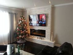 New No Cost electric Fireplace Remodel Thoughts This Homeowner Took A Boring Wall And Made It Into The Most Awesome Part Of The House Fireplace Wal Build A Fireplace, Fake Fireplace, Fireplace Remodel, Fireplace Wall, Fireplace Stone, Tv Wall Mount Installation, Living Room Designs, Living Room Decor, Fireplace Inserts
