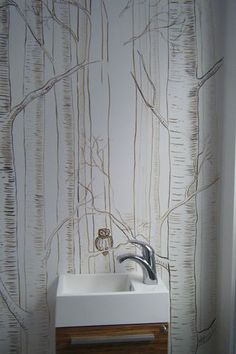 Birch trees w/owl painted on bathroom wall.