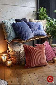 Elevate your living room style with cushions of different textures, finishes, prints and hues.