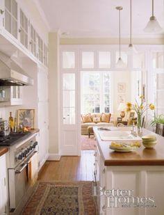 Love this kitchen/family room arrangement & the connecting doorway.