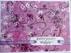 Pretty purple floral; stamped some swirls with black ink, then cut to card size. Finished with a fluorescent ribbon going through the sentiment tag...