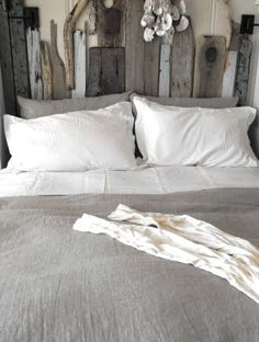 Lovely photography and lighting again. Look at how these colors work so well together. Of course I love the driftwood headboard.
