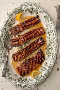 Salmon Glazed with Rosemary- and Lemon-Infused Honey - Rosemary-infused honey gives this dish a sweet and aromatic flavor. http://www.saveur.com/article/Recipes/Salmon-Glazed-with-Rosemary--and-Lemon-Infused-Honey
