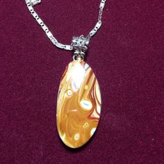 Beautiful Rolling Hills Domolite sterling pendant Solid sterling silver (marked 925) pendant with amazing genuine stone!  I love the creaminess of the colors in this beautiful stone. This stone is more on the rare side and is just full of happiness and sunshine🌞🌞🌞 sterling Jewelry