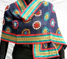 This stunning  bluish black georgette dupatta/stole is embroidered with wool using traditional phulkari embroidery in a floral pattern, and has a broad golden lace border. A lovely, innovative creation from the artisans of Punjab and a unique handmade product. - See more at: http://giftpiper.com/Handmade_Blue_Black_Georgette_Phulkari_Dupatta_Stole-id-224683.html#sthash.Cd1oKkH4.dpuf