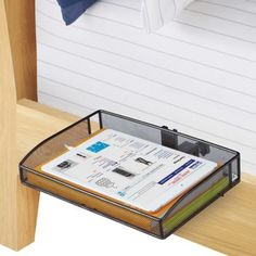 This Mesh Clip-On Bunk Shelf can attach to a bed post, or night stand to provide practical storage for essentials right where you need it. Makes an ideal place to store an electronic tablet, books, or eyeglasses as you prepare to fall asleep in bed.