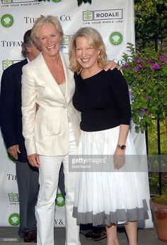 Glenn Close (L) and Bette Midler share a moment at Bette Midler's New York Restoration Project's 4th Annual Picnic at Spanish Harlem's Thomas Jefferson Park on June 14, 2005 in New York City.