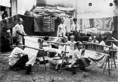 Production of batik cloth in Java, Dutch East Indies, 1912. Image via Wikipedia Commons