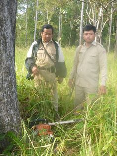 Sieng Darong (left), a forestry administration ranger, and Sab Yoh, a police officer, were shot in their hammocks while patrolling a protected forest in Cambodia on Nov. 7.