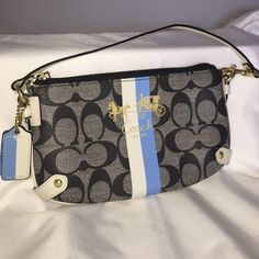 Authentic  coach 2-way Wristlet 2-way authentic Coach Wristlet. Can be used as in first pic..like a small purse or as a regular Wristlet, with the handle on the side. Blue lining inside has a small stain as in pic 4. No stains or rips of any kind on outside. Gray, blue, black and cream colors. Coach writing in front w gold coloring. 8 1/2 wide and 5 tall. Goes with everything... Coach Bags Clutches & Wristlets