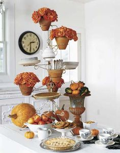 Buffet Centerpiece. An antique plantstand makes a great container for mums, pies, even a terra cotta pot filled with forks!