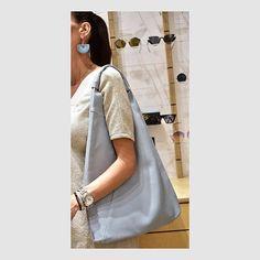 Leather tote bag 💙 . #leatherbag #totebag #lightbluebag #ceramicearrings #instastyle #ootd #summerbag #summerlook #styleversabag #styleversa