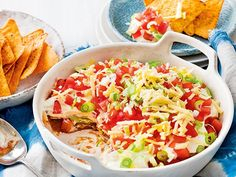 """""""This layered dip is definitely a winner! Next time I'm going to try mixing some taco seasoning with the sour cream, which is an idea suggested…"""