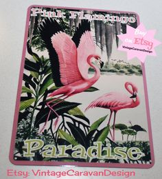 Pink Flamingo Paradise!! This is a fun tin sign for the flamingo fan...whether it be for your home or in your vintage caravan/trailer! Its such a pretty sign! I have created this new tin sign using a mix of old art and new technology. It is a nice quality item and an ideal soze for that odd spot in your camper!  If you are like me you can never have enough pink flamingo items!! ;) This sign is professionally made by me. It is aluminium, 30.5cm x 20.5cm (8x 12inches). 4 holes in the corne...