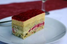 The Wandering Girl: Entremet biscuit broken pistachios and honey, vanilla cream and raspberry chips, mango mousse passion