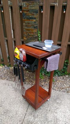 """outdoor prep station is a great grill companion with it's 18""""x 18""""x 32"""" high counter top for a little extra space while grilling. It is also outfitted with utensil hooks and condiment cup and hand towel bar, this model has cast iron castors for exception rolling and stunning good looks. The King Western is 100% pine wood or cedar wood ripped from a single 12""""x 10""""x 2"""" and stained with your choice of finishhttps://www.etsy.com/people/cliffordhetrick?ref=hdr_user_menu"""
