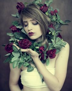 Woman enveloped by roses.