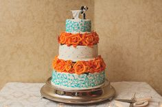 We love weddings were the groom gets involved in the planning. In Robert and Julie's case, the groom is responsible for the bold color scheme: Aqua and t