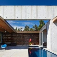Lavaflow House:  by Craig Steely Architecture.  The main feature of the house is a concrete beam, 140 foot long, 48 inch tall x 12 inch wide running the length of the building with only three short concrete walls supporting it along its massive span. The concrete beam allows for sizable spans of uninterrupted glass and covered outdoor space, creating a permeable edge between the man-made and nature, amplify the sensation of living in the Ohia forest.