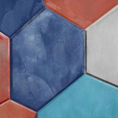 Contemporary geometric piece in blues and red. This piece is a part of a series of four, Polyhedron I, II, III, and IV.