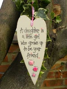 Handmade Wooden plaque A daughter is a little girl that grows up to be your friend. £12.00, via Etsy.