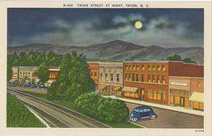 Vintage postcard of Trade Street at night in Tryon, North Carolina.