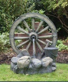 garden water features Cartwheel on Wall Fountain Water Feature uk Found it at Wayfair Polyresin and Fiberglass Tiered Wood Cask Fountain Garden Water Wheel Piper in Te. Diy Water Feature, Backyard Water Feature, Indoor Water Fountains, Garden Fountains, Fountain Garden, Solar Fountains, Outdoor Fountains, Garden Pond, Garden Tips
