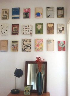 use plate hooks to hang vintage books on the wall
