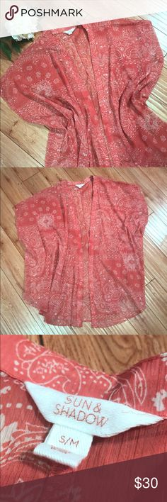 """Sun & Shadow Peach Flow Kimono Sun & Shadow dark peach/pink sheer kimono white white paisley pattern. Perfect summer shirt or beach coverup! Front hem length 35"""", slouchy oversized. Size S/M.  Measurements approximate. Color may vary slightly from pictures due to lighting.   🌟Top rated seller & Posh Ambassador!  🌟 4.9 customer rating! 🌟 Smoke free pet free home! 🌟 Next day shipping!  🌟 Top 10% seller! Sun & Shadow Tops Blouses"""