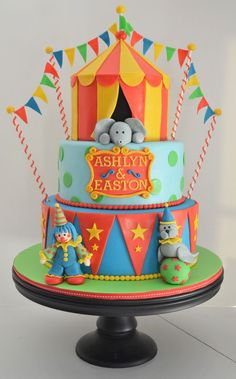 This circus cake was for a brother and sister turning...