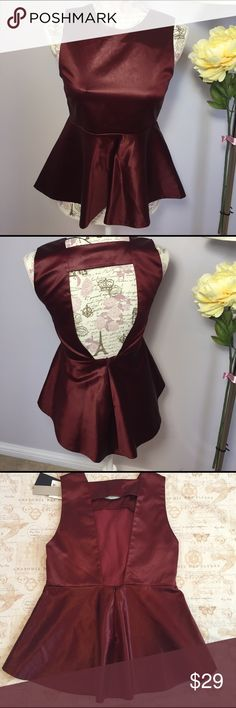 "Zara Studio Peplum Top NWT! Beautiful great quality Zara satin Peplum Top. Burgundy. 52% Cotton, 45% Acetate & 3% Elastane. Exposed High-Low back. Concealed zip for back closure. 15"" pit to pit. 21"" shoulder to hem. New with tags. Zara Tops"