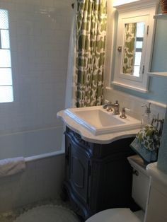 Every detail in this bathroom works so well together. The focal pieces, such as the sink, really help to give this bathroom the character the owners wanted. The high walls on the tub make it perfect for bubble baths. Although it is small, the space is well used and still is inviting.