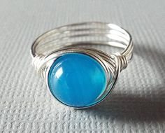 This wire wrapped ring features a Blue Agate bead (8 mm). Dont you love the ocean blue hue of the stone? The translucent color is quite
