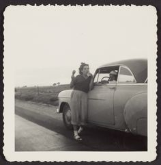 Girl leaning on car; Unknown; United States; 1950s; Gelatin silver print; 7.6 x 7.6 cm (3 x 3 in.); 2009.141.104; Gift of Sharon and Michael Blasgen and Michael Wilson; Copyright: Status undetermined