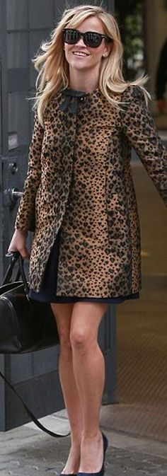 Leopard print coat with a black bow tie + black accessories.