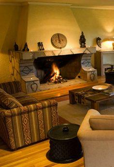 Cosy up at the fireplace at Sabyinyo Silverback Lodge