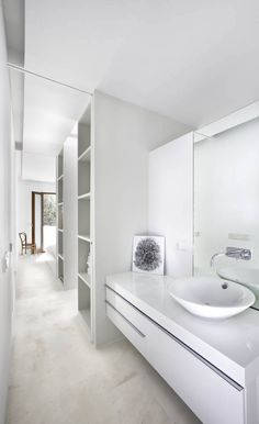 Narrow space looks larger in all white; love the storage cubbies::BATHROOMS:: #bathroombeauties