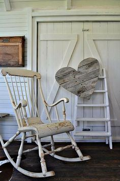 Large wooden heart hanging on a ladder