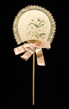 Wood, cotton and silk fixed fan, 1880s. Courtesy of the Met.