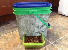 DIY dry-food dispenser. A disposable aluminium pan is used on the inside to help direct all the food into the tray.