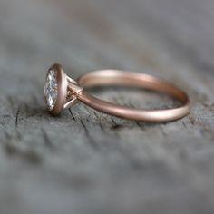 Moissanite Ring,  Rose Gold Engagement Ring , Unique 14k Satellite Ring Design for the Modern Bride // Conflict Free Diamond Alternative by onegarnetgirl on Etsy https://www.etsy.com/listing/105160135/moissanite-ring-rose-gold-engagement