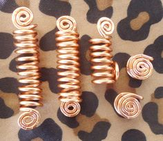 A Hair Jewls set thats handcrafted in a five piece set that includes three Loc Cuffs and two Loc Dots.  This set fits size 7mm Locs, Braids,Twist etc...