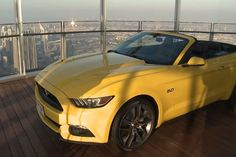 See how to get a Mustang on top of the world's tallest building.