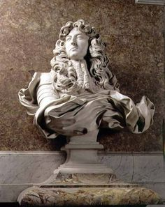"""Gianlorenzo Bernini, Bust of Louis XIV, marble, 1665, the Versailles Palace, Paris.  It has been called the """"grandest piece of portraiture of the baroque age"""".   Extraordinary amounts of attention detail in achieving textures of materials, hair and other features, no colour palette used (creating seriousness of bust). Marble?- suggests wealth and the fact that the face is facing away suggests wealth also as well as superiority"""